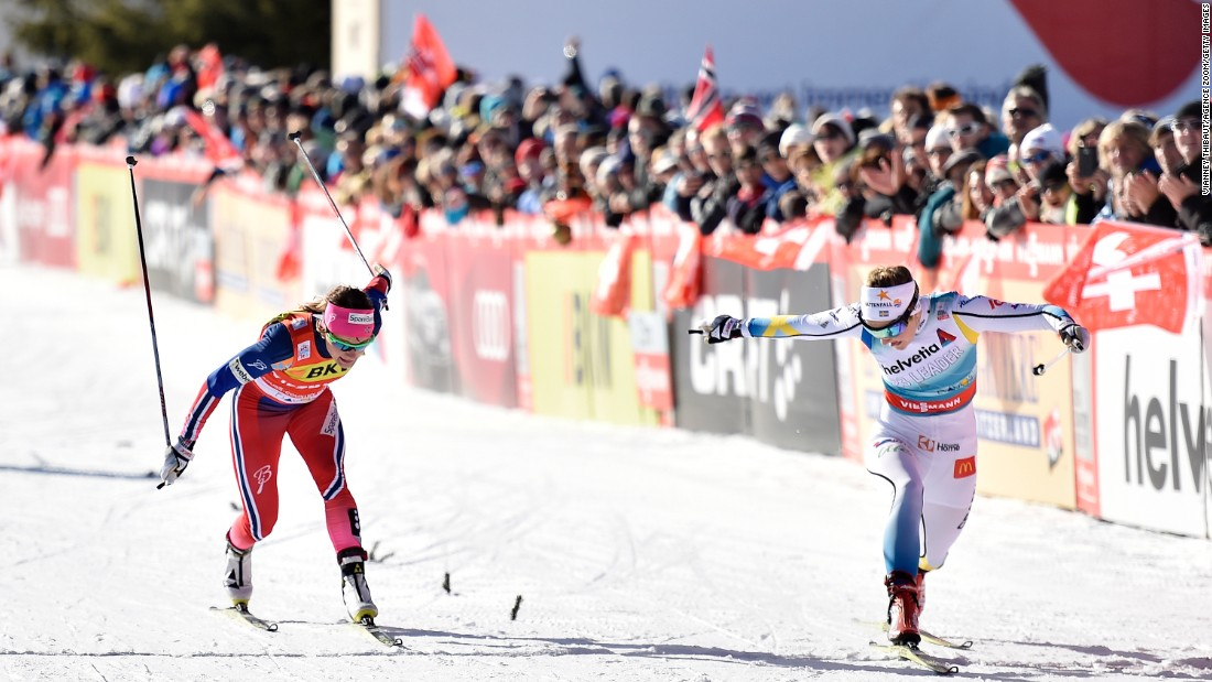 Sweden's Stina Nilsson, right, edges Norway's Maiken Capsersen Falla during a cross-country skiing race in Davos, Switzerland, on Sunday, December 13.