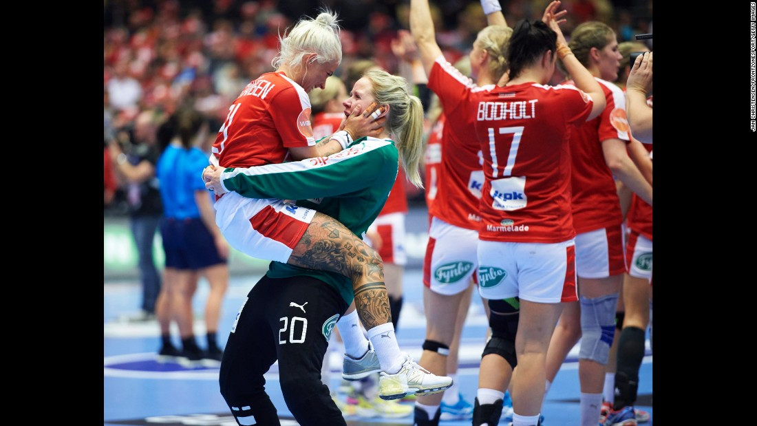 Teammates Kristina Kristiansen, left, and Rikke Poulsen celebrate Sunday, December 13, after Denmark won its round-of-16 match at the Handball World Championship.