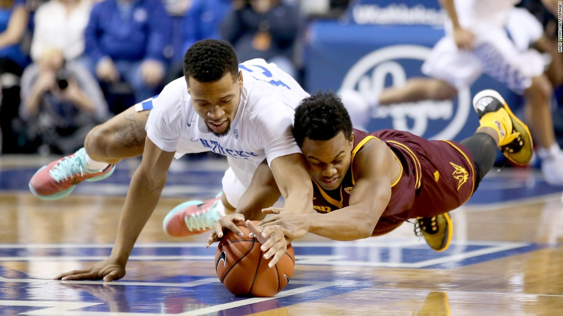 Kentucky's Isaiah Briscoe, left, and Arizona State's Tra Holder dive for a loose ball during a game in Lexington, Kentucky, on Saturday, December 12.