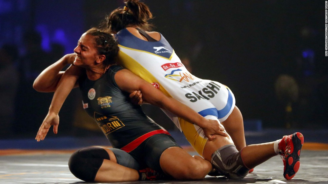 Geeta Phogat, left, competes against Sakshi Malik during a Pro Wrestling League event in New Delhi on Thursday, December 10. Malik won the bout.