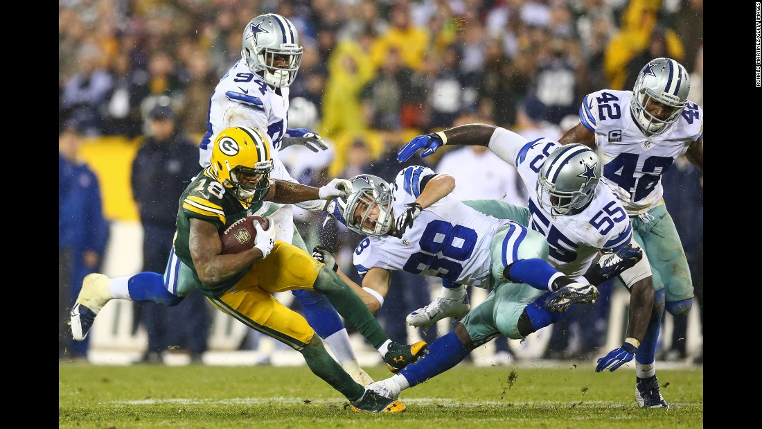 Dallas' Jeff Heath (No. 38) collides with Green Bay's Randall Cobb during an NFL game in Green Bay, Wisconsin, on Sunday, December 13.