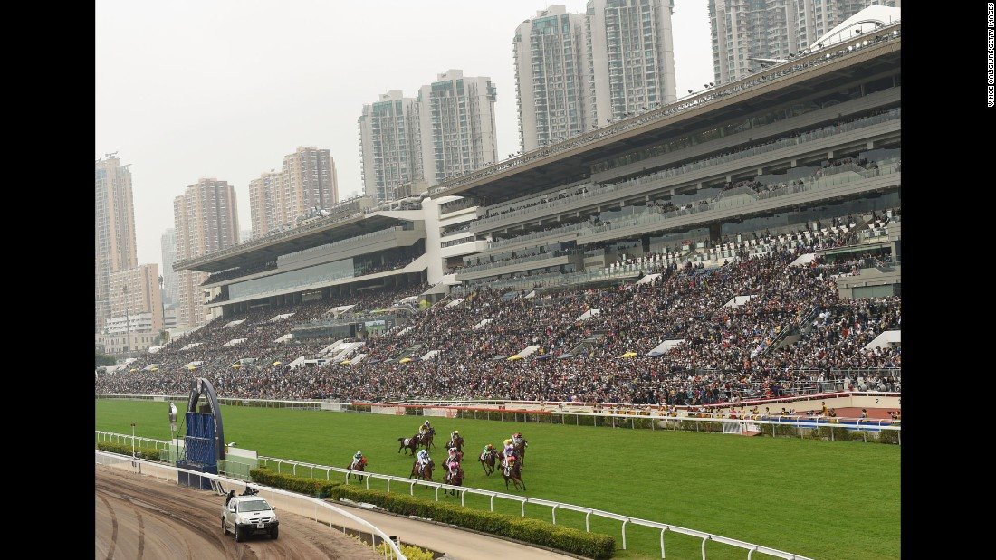 Horses race at the Sha Tin Racecourse in Hong Kong on Sunday, December 13.
