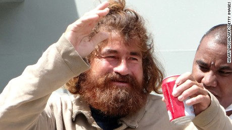 A Salvadorean castaway who identified himself as Jose Ivan and later told that his full name is Jose Salvador Alvarenga walks with the help of a Majuro Hospital nurse in Majuro after a 22-hour boat ride from isolated Ebon Atoll on February 3, 2014. Jose was washed up on Ebon Atoll on January 30, 2014, and told his rescuers he set sail from Mexico for El Salvador in September 2012 and has been floating on the ocean ever since.    AFP PHOTO / Hilary Hosia        (Photo credit should read HILARY HOSIA/AFP/Getty Images)