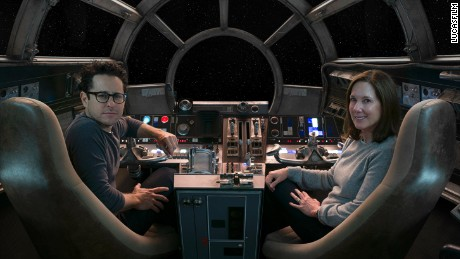 Director/producer/screenwriter J.J. Abrams and producer Kathleen Kennedy in the cockpit of Episode VII's Millennium Falcon.