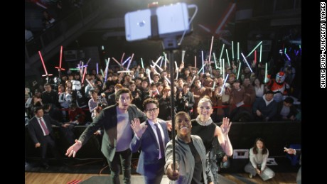 SEOUL, SOUTH KOREA - DECEMBER 09:  Actor John Boyega (2nd R) takes selfie with actor Adam Driver (L) director J.J. Abrams (2nd L) and actress Daisy Ridley (R) during the event for fans ahead of 'Star Wars: The Force Awakens' South Korea premiere at the Octagon on December 9, 2015 in Seoul, South Korea.  (Photo by Chung Sung-Jun/Getty Images for Walt Disney Studios)
