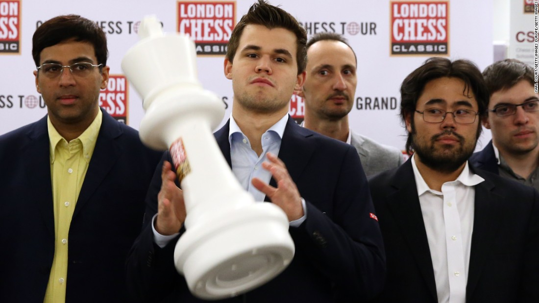 World No. 1 chess player, Magnus Carlsen, celebrates after winning the prestigious 2015 London Chess Classic... surrounded by some less-than-enthusiastic opponents.