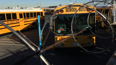 Los Angeles School District buses are parked at their bus garage in Gardena, Calif., Tuesday, Dec. 15, 2015. The nation's second-largest school district shut down Tuesday after a school board member received an emailed threat that raised fears of another attack like the deadly shooting in nearby San Bernardino. (AP Photo/Damian Dovarganes)