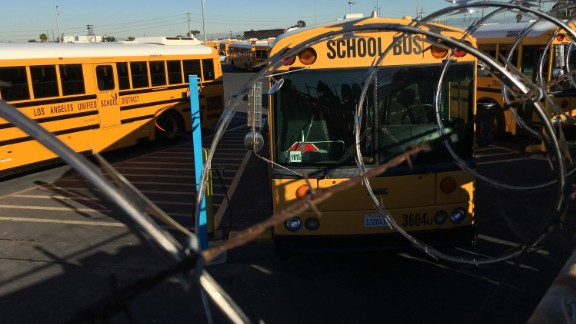 Los Angeles School District buses are parked at their bus garage in Gardena, Calif., Tuesday, Dec. 15, 2015. The nation