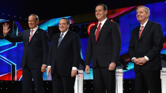 """Four Republican presidential candidates take the stage for the """"undercard"""" debate featuring lower-polling candidates. From left are former New York Gov. George Pataki, former Arkansas Gov. Mike Huckabee, former U.S. Sen. Rick Santorum and U.S. Sen. Lindsey Graham."""