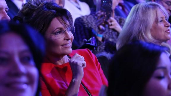 Former Alaska Gov. Sarah Palin -- Sen. John McCain's running mate in 2008 -- watches the debate from the audience.