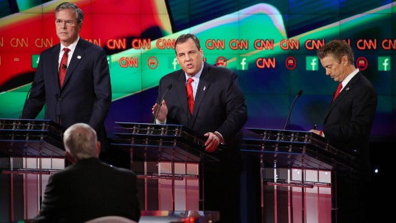 """New Jersey Gov. Chris Christie, center, makes a point between former Florida Gov. Jeb Bush, left, and U.S. Sen. Rand Paul. """"I'm a former federal prosecutor,"""" Christie said during the debate. """"I've fought terrorists and won, and when we get back in the White House we will fight terrorists and win again and America will be safe."""" Much of Tuesday night's debates focused on national security and the ISIS terror threat."""