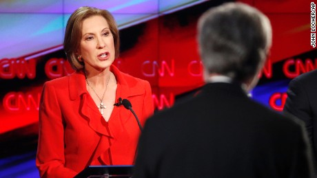 Carly Fiorina, left, responds to a question from debate moderator Wolf Blitzer during the CNN Republican presidential debate at the Venetian Hotel & Casino on Tuesday, Dec. 15, 2015, in Las Vegas. (AP Photo/John Locher)