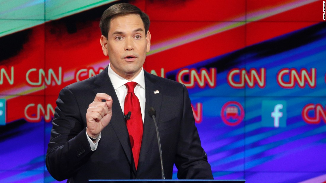 "U.S. Sen. Marco Rubio answers a question during the debate. ""Today you have millions of Americans that feel left out and out of place in their own country, struggling to live paycheck to paycheck, called bigots because they hold on to traditional values,"" the junior U.S. senator from Florida said. ""And around the world, America's influence has declined while this president has destroyed our military, our allies no longer trust us, and our adversaries no longer respect us. And that is why this election is so important."""