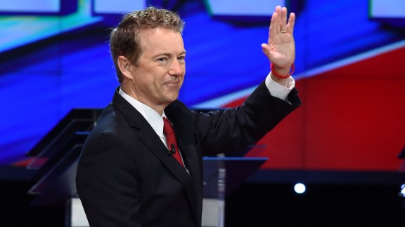 """Paul waves as he takes the stage before the start of the debate. """"I think we defeat terrorism by showing them that we do not fear them,"""" said the junior U.S. senator from Kentucky. """"I think if we ban certain religions, if we censor the Internet, I think that at that point the terrorists will have won."""""""