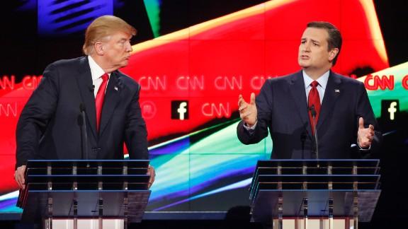 Businessman Donald Trump watches U.S. Sen. Ted Cruz speak Tuesday, December 15, during a Republican presidential debate in Las Vegas.