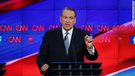 Republican presidential candidate Mike Huckabee speaks during the CNN Republican presidential debate on December 15, 2015.