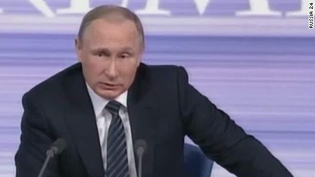 Putin says downing of Russian plane was an 'enemy act'