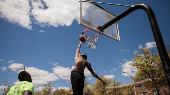 Two men play basketball in William Mcabee Park.