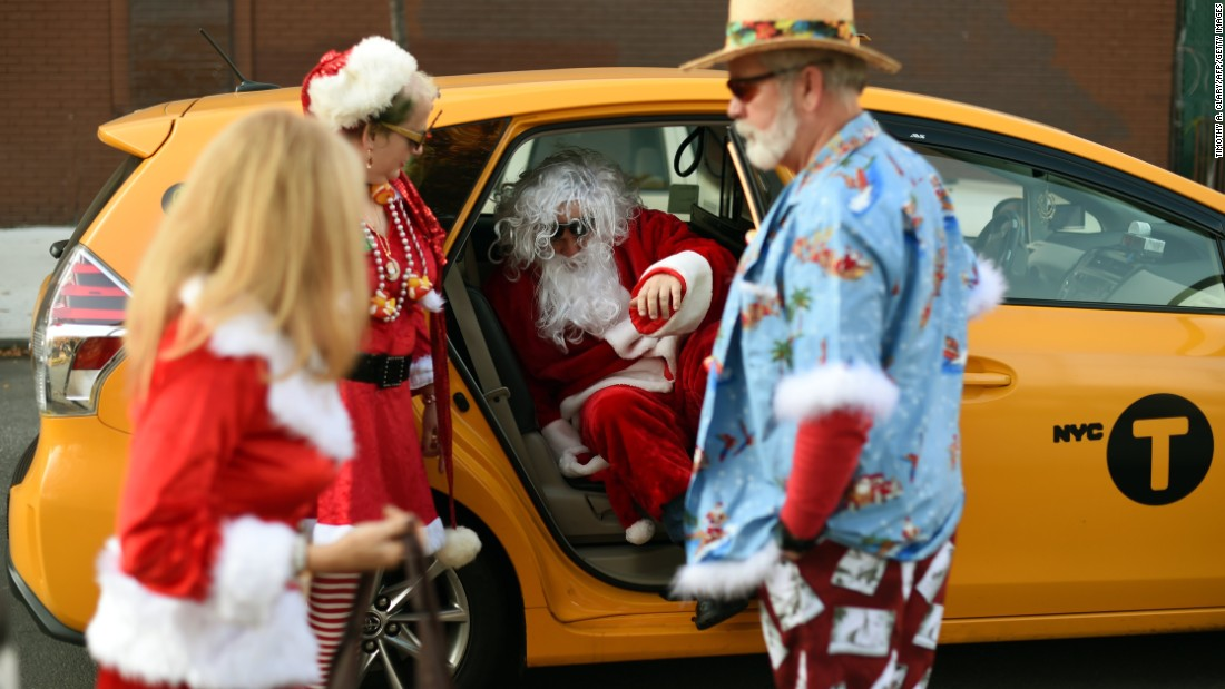 People dressed as Santa Claus gather in McCarren Park during the SantaCon event in New York City on Saturday, December 12.