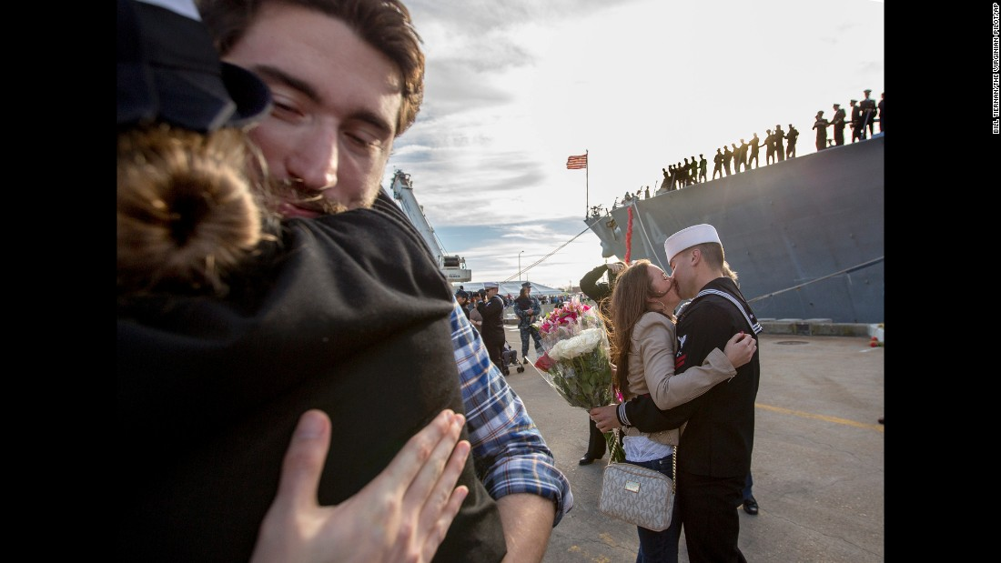 U.S. sailors embrace their significant others in Norfolk, Virginia, as they return from an eight-month deployment on Monday, December 14.
