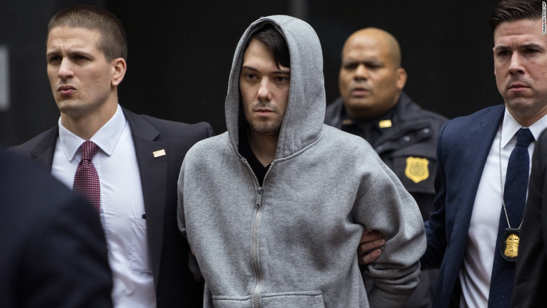 "Law enforcement agents escort pharmaceutical CEO Martin Shkreli <a href=""http://money.cnn.com/2015/12/17/news/companies/martin-shkreli-arrest-reports/"" target=""_blank"">after his arrest in New York</a> on Thursday, December 17. Shkreli was indicted on charges that he bilked a biotech company out of millions of dollars. Prior to his arrest, Shkreli <a href=""http://money.cnn.com/2015/09/22/investing/aids-drug-martin-shkreli-750-cancer-drug/index.html?iid=EL"" target=""_blank"">had been called the ""most-hated man in America""</a> for jacking up the prices of a drug used to treat AIDS patients."