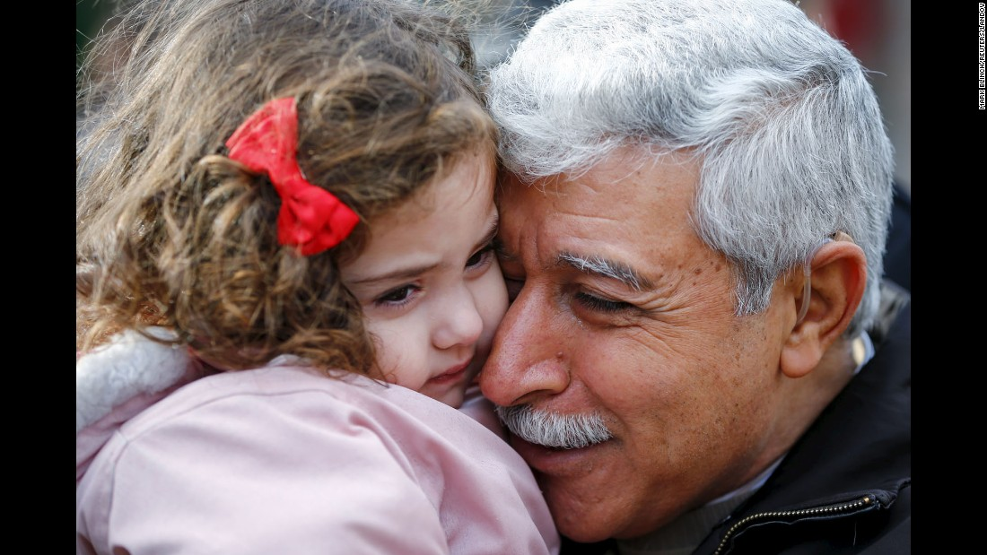 Syrian refugee Hagop Manushian is reunited with his granddaughter Rita at the Armenian Community Center in Toronto on Friday, December 11.