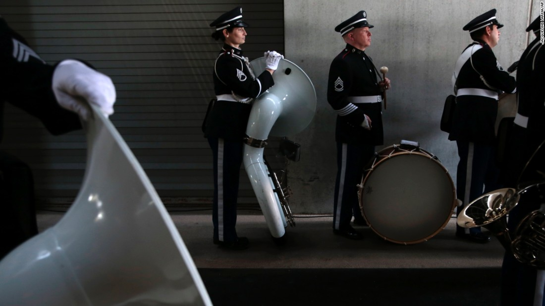 Band members from the U.S. Military Academy gather before the Army-Navy football game Saturday, December 12.