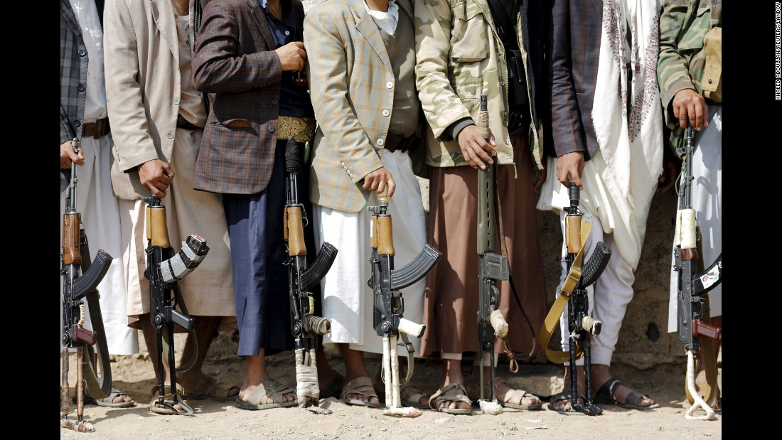 Tribesmen loyal to the Houthi rebel movement hold their weapons in Sanaa, Yemen, on Tuesday, December 15.
