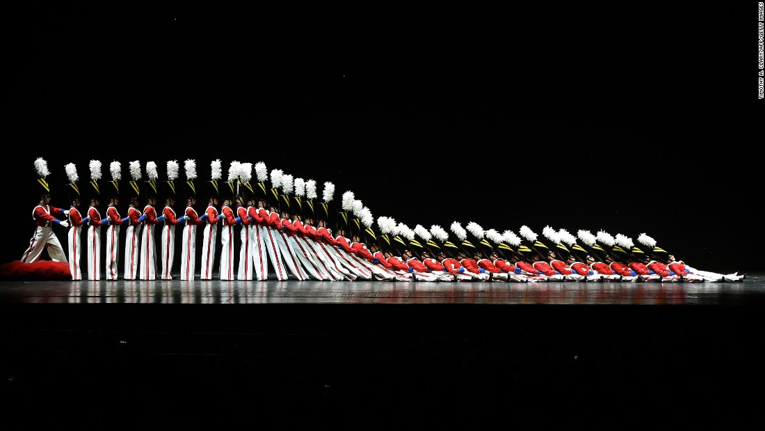 "<strong>December 2: </strong>The Rockettes tumble down in the ""Parade of the Wooden Soldiers"" during the Radio City Christmas Spectacular in New York. The holiday performance has been an annual event since 1932."