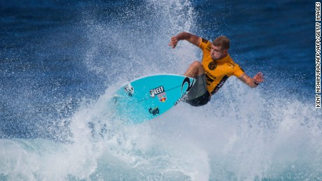 3c5aa2eb53 Mick Fanning surfs during the Pipeline Masters event of the Vans Triple  Crown in Hawaii on