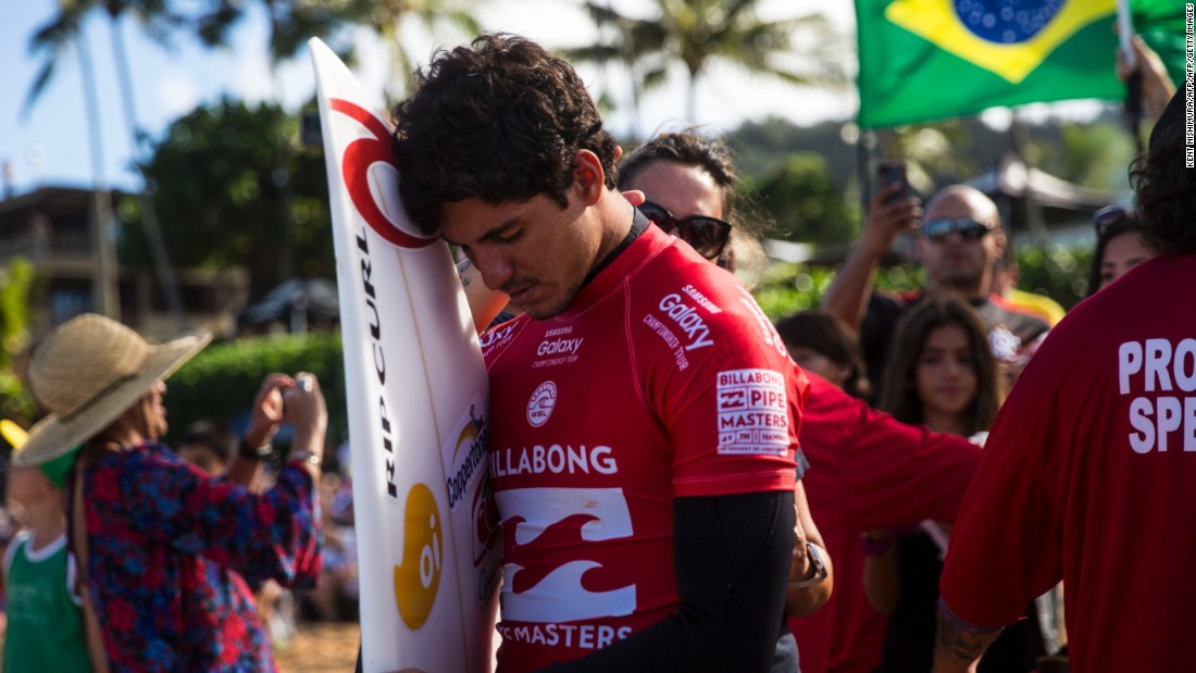 Surfer Gabriel Medina of Brazil pauses for a moment before running into the water at Ehukai Beach Park on December 17.