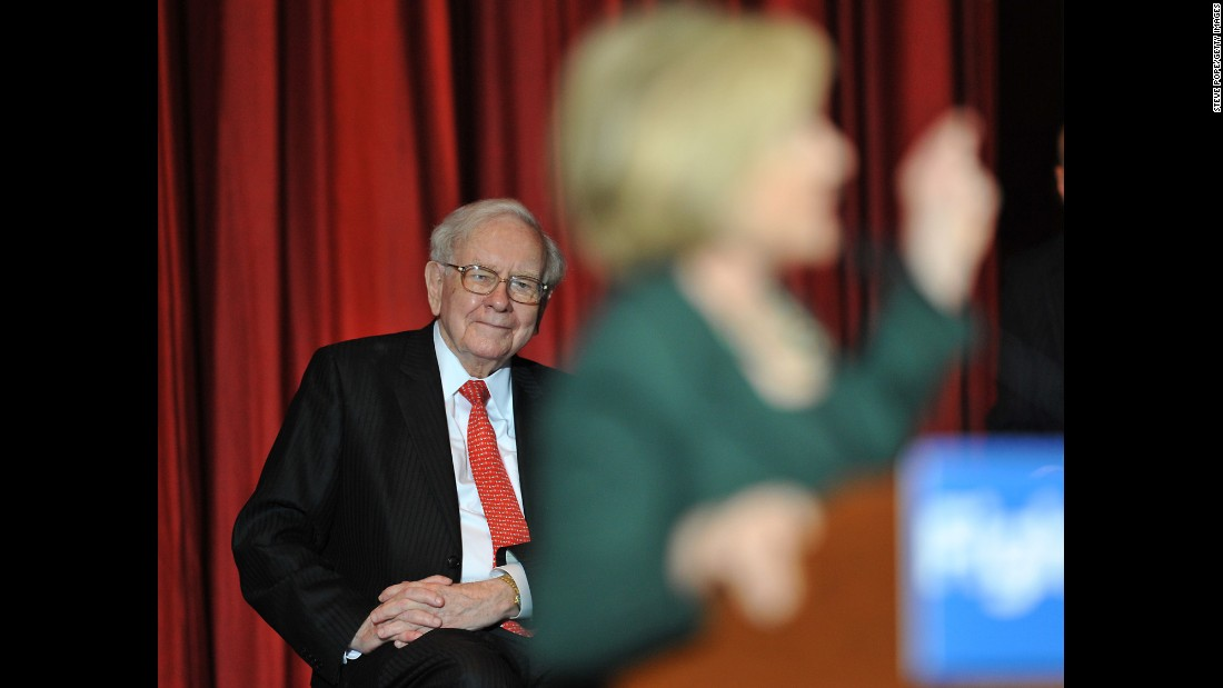 "Billionaire businessman Warren Buffett listens to Democratic presidential candidate Hillary Clinton as she speaks in Omaha, Nebraska, on Wednesday, December 16. Buffett <a href=""http://www.cnn.com/2015/12/16/politics/hillary-clinton-warren-buffett-rule-omaha/"" target=""_blank"">hosted a fundraiser for Clinton</a> before the rally."