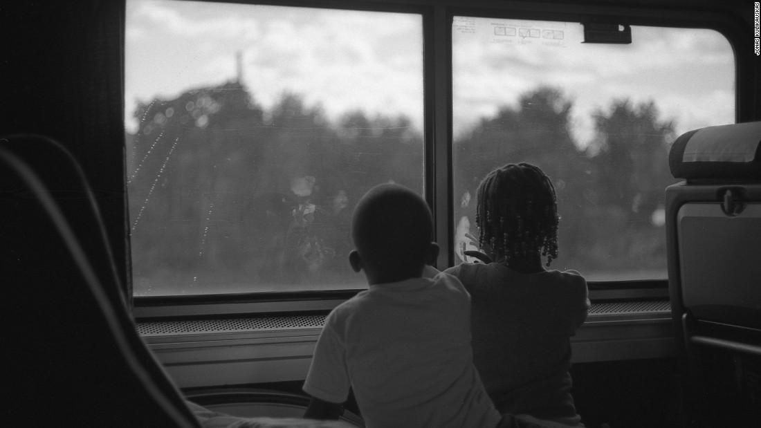Two children peer out the window of Amtrak's Southwest Chief train as it rolls west.
