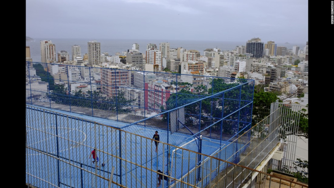 Men play soccer in the Cantagalo favela. Rio will host the 2016 Olympic Games.