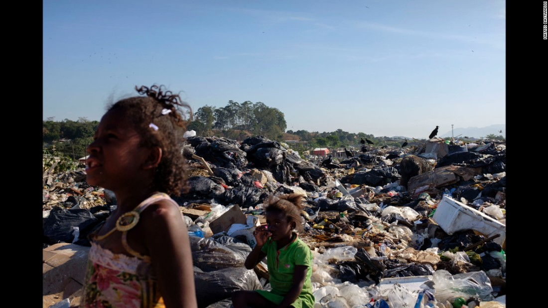 Two young girls are seen in Jardim Gramacho. While it was in operation, it was one of the largest landfills in the world.