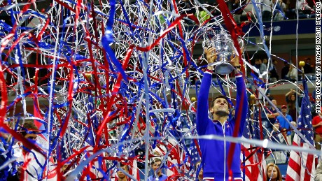 NEW YORK, NY - SEPTEMBER 13:  Novak Djokovic of Serbia celebrates with the trophy after defeating Roger Federer of Switzerland during their Men's Singles Final match on Day Fourteen of the 2015 U.S. Open at the USTA Billie Jean King National Tennis Center on September 13, 2015 in the Flushing neighborhood of the Queens borough of New York City.  (Photo by Mike Stobe/Getty Images for the USTA)
