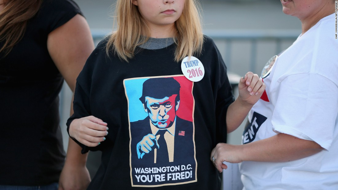A young woman wears a Trump T-shirt before a rally in Richmond, Virginia, on October 14.