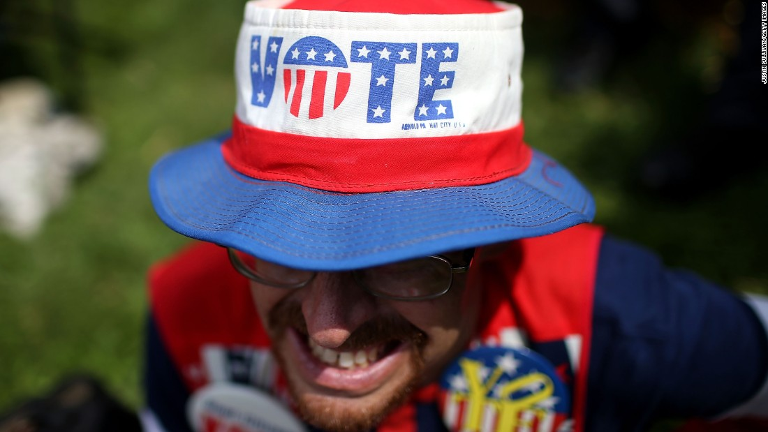 John Olsen wears a patriotic outfit August 13 as he watches former Democratic presidential candidate Jim Webb speak at the Iowa State Fair in Des Moines.