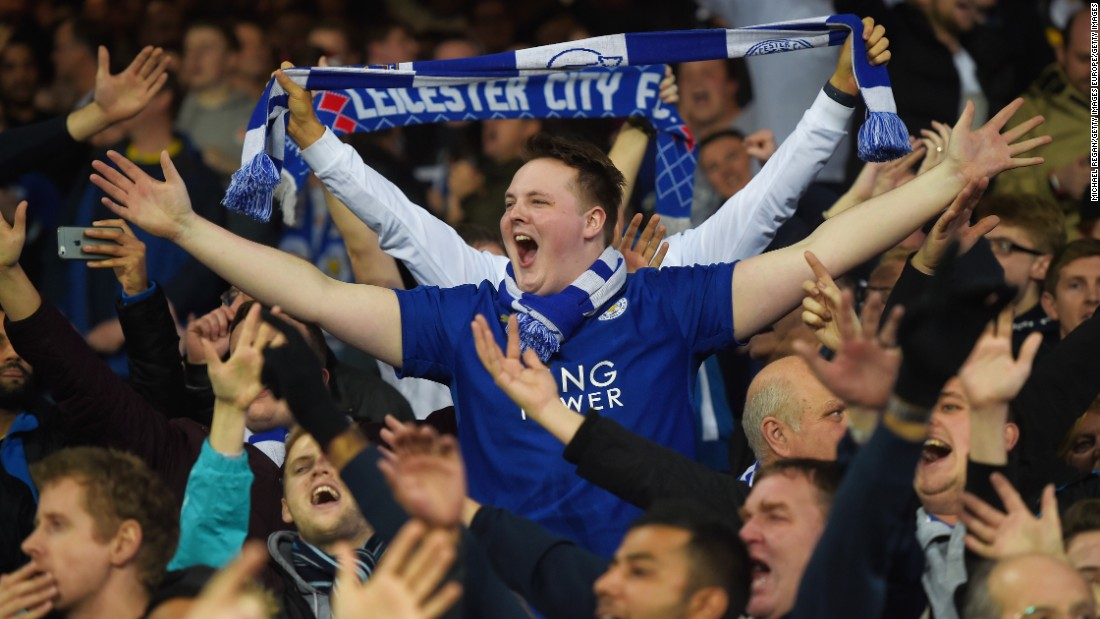 Leicester City supporters celebrate their team's 3-2 win against Everton at Goodison Park.