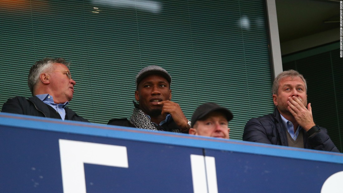 Chelsea interim manager Guus Hiddink (L), Blues legend Didier Drogba (C) and Chelsea owner Roman Abramovich (R) talk prior to match between Chelsea and Sunderland at Stamford Bridge.
