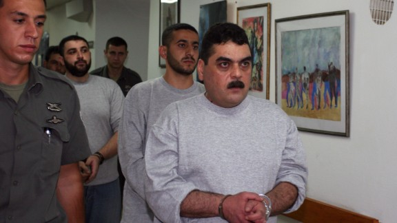 Samir Kuntar is taken to be processed for release on July 16, 2008, at the Hadarim Prison in central Israel.