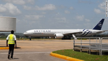 An Air France flight sits on the runway Moi International Airport in Mombasa, Kenya. The plane was diverted there after a suspicious device was reported on board.