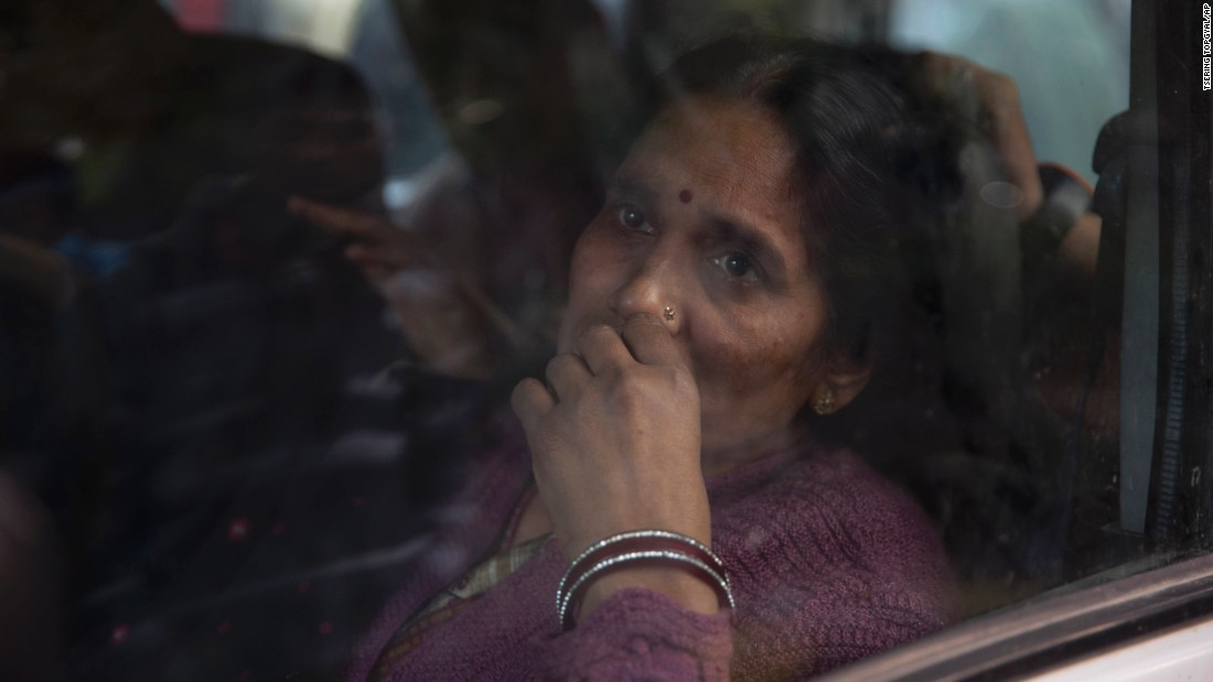 The mother of the victim of the fatal 2012 gang rape that shook the country sits in a car after she arrived to join protesters in New Delhi on Sunday.