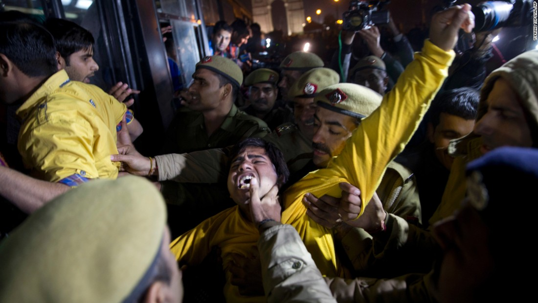 An Indian man shouts slogans as he is detained by police during the protest.