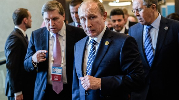 Russian President Vladimir Putin (C) arrives on day two of the G20 Turkey Leaders Summit on November 16, 2015 in Antalya. Putin said on November 16 that the attacks in Paris showed the need for his proposal for an international anti-terror coalition to be realised.