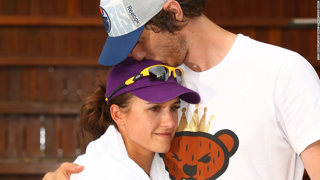 Tennis player Arina Rodionova is consoled by her newly-betrothed, Tyrone Vickery, after losing an Australian Open qualifier the day after their wedding.