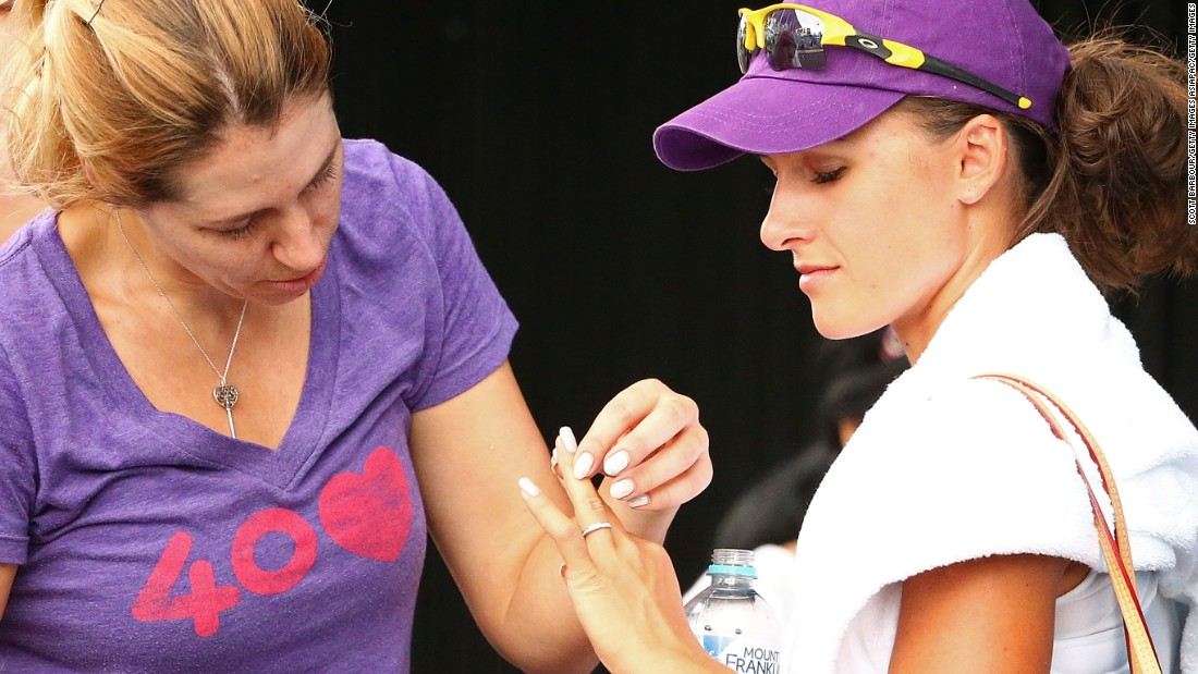 It was the third time Rodionova had lost the playoff final for the Australian Open -- where she was beaten in the first round in her only two singles appearances, in 2011 and 2015. Here she shows Ukrainian player Olga Savchuk her wedding ring.
