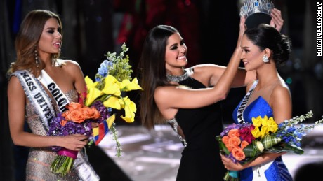 Miss Philippines 2015, Pia Alonzo Wurtzbach (R), reacts as she is crowned the 2015 Miss Universe by 2014 Miss Universe Paulina Vega (C) during the 2015 Miss Universe Pageant at The Axis at Planet Hollywood Resort & Casino on December 20, 2015 in Las Vegas, Nevada. Miss Colombia 2015, Ariadna Gutierrez, was mistakenly named as Miss Universe 2015 instead of First Runner-up.