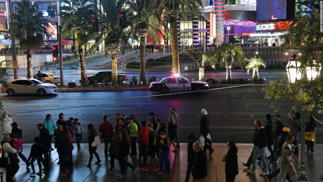 Pedestrians walk down the Las Vegas Strip after police closed it to traffic on December 20.