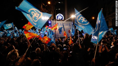 MADRID, SPAIN - DECEMBER 20:  Popular Party supporters wave to Spanish Prime Minister Mariano Rajoy on the balcony at Popular Party headquarters after his party won the most votes during General Elections on December 20, 2015 in Madrid, Spain. Spaniards went to the polls today to vote for 350 members of the parliament and 208 senators. For the first time since 1982, the two traditional Spanish political parties, right-wing Partido Popular (People's Party) and centre-left wing Partido Socialista Obrero Espanol PSOE (Spanish Socialist Workers' Party), held a tight election race with two new contenders, Ciudadanos (Citizens) and Podemos (We Can) attracting right-leaning and left-leaning voters respectively.